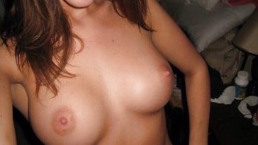 Cheerful babe posing topless
